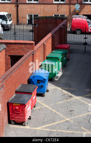 Large Biffa wheelie bins for commercial waste at the back of a premises in a city centre. - Stock Photo