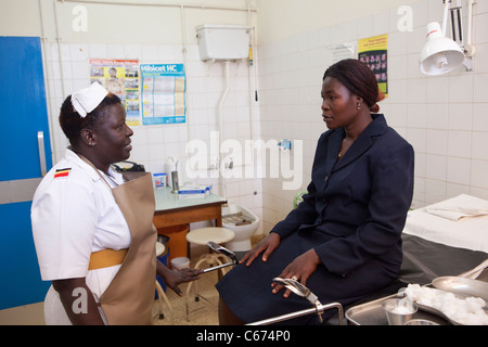 A nurse consults with a patient at Mbale Regional Referral Hospital in Mbale, eastern Uganda. - Stock Photo