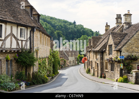 View down the main street in the picturesque village of Castle Combe, Wiltshire, England, UK - Stock Photo