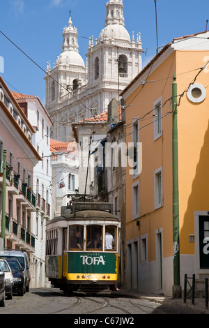Tram in narrow streets below Igreja de Sao Vicente de Fora , Alfama district, central Lisbon, Portugal - Stock Photo