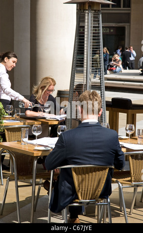 Office workers at lunchtime, Warwick Court, Paternoster Square, financial district, City of London. London, UK - Stock Photo