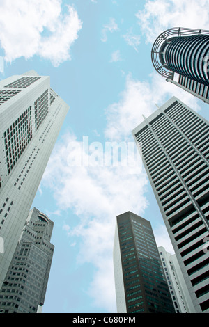Singapore skyscrapers buildings taken from low angle with blue skies on the background - Stock Photo