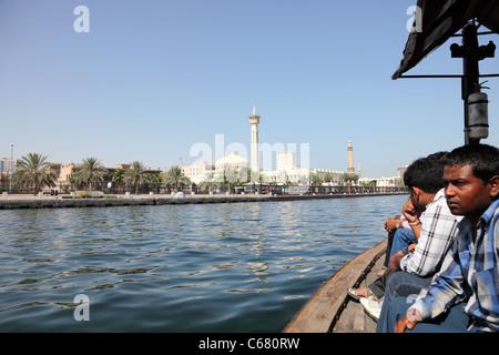 Crossing the Dubai Creek in a traditional Abra boat, Dubai, United Arab Emirates - Stock Photo