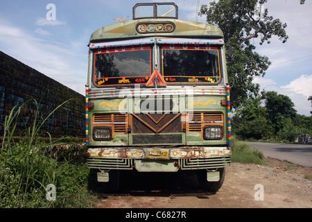 Dilapidated Indian bus on the roadside in the Punjab India - Stock Photo