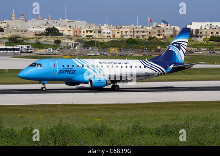 EgyptAir Express Embraer 170 small passenger jet airliner on the runway while departing from Malta - Stock Photo