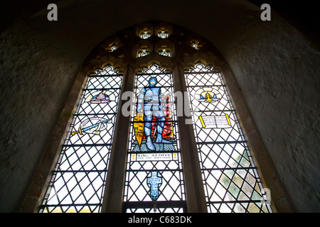 Stained glass window depicting King Arthur in St Nectan's church near Hartland in North Devon UK - Stock Photo