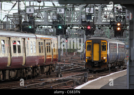 View of  class 156 dmu entering Glasgow Central station seen on the bridge over the River Clyde next to a class - Stock Photo