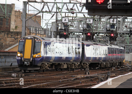 View of a new class 380 emu entering Glasgow central station seen on the bridge over the River Clyde. - Stock Photo