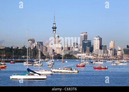 Boats moored in Okahu Bay with the city center and Sky Tower in the background. Auckland, North Island, New Zealand, - Stock Photo