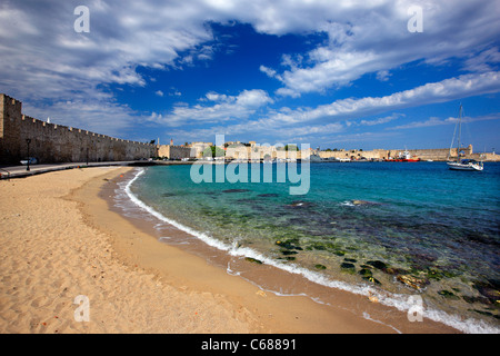 The sandy beach and  the seaside walls, at Sahtouri coast,   Medieval town of Rhodes (World Heritage site by UNESCO), - Stock Photo