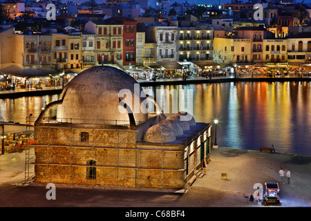 Partial view of the old Venetian harbor of Chania town in the 'blue' hour, Crete island, Greece. - Stock Photo