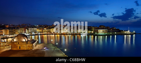 Panoramic view of the old Venetian harbor of Chania town in the 'blue' hour, Crete island, Greece. - Stock Photo