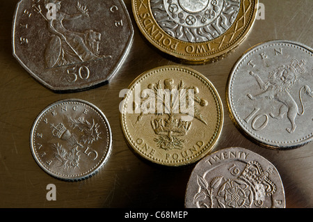 UK coins / money - Scottish £1 pound, £2 pounds, 50p, 10p and 5 pence coin - close up view.