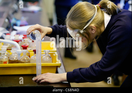 A secondary school pupil in a chemistry lesson in a UK school - Stock Photo
