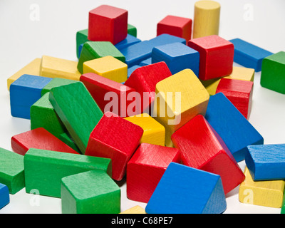viele bunte Holzbausteine | a lot of colored wooden building blocks - Stock Photo