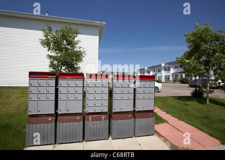 canada post residential mailboxes postboxes on condominium managed property Saskatoon Saskatchewan Canada - Stock Photo