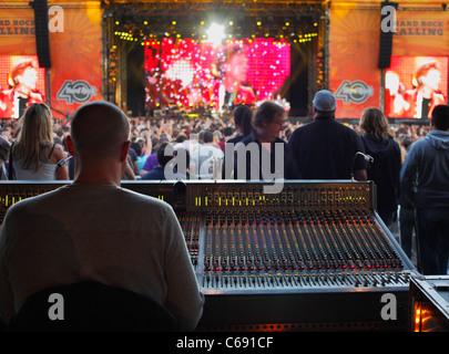 Audio mixer David Eisenhauer at a Bon Jovi rock concert. - Stock Photo