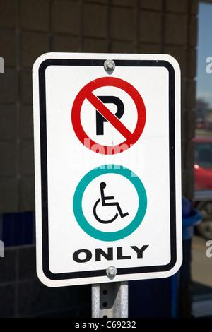 no parking restriction signs signposts disabled parking only Saskatoon Saskatchewan Canada - Stock Photo