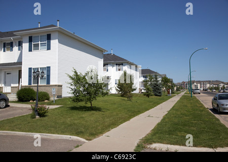 A Row Of New Townhouses Or Condominiums Stock Photo