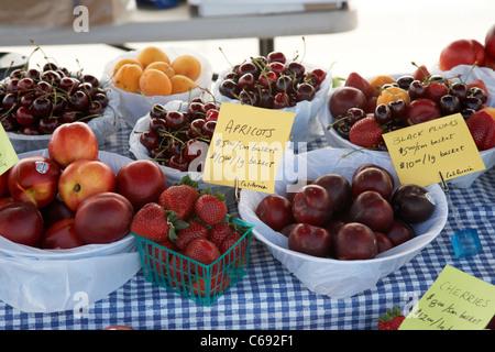 farmers market fruit stall with fresh fruits on sale Saskatoon Saskatchewan Canada - Stock Photo