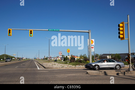 green light at light junction on dual carriageway trans-canada highway Brandon Manitoba Canada - Stock Photo