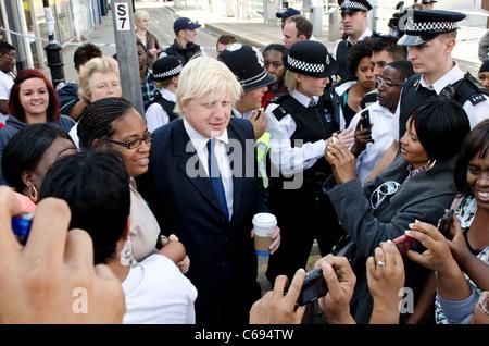 Boris Johnson mayor of London meets crowds after Croydon riots. - Stock Photo