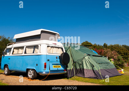 A VW camper set up camp along with tent on a Uk camping site - Stock Photo