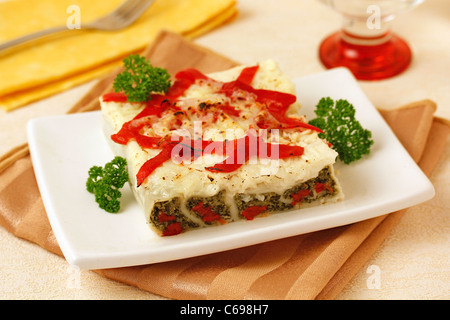 Spinach cannelloni with tuna and peppers. Recipe available. - Stock Photo