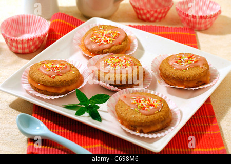 Whoopies of oats with strawberry cream. Recipe available. - Stock Photo