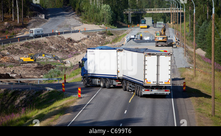 Roadworks on a highway divert traffic to a temporary road , Finland - Stock Photo