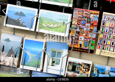 Postcards for sale outside a shop in Sneem, County Kerry, Ireland - Stock Photo