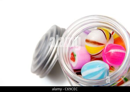 Candies inside Glass Jar - Stock Photo