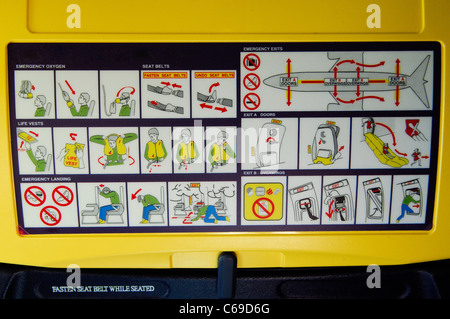 Passengers flight safety informations on back seat of Ryanair's Boeing 737 - Stock Photo