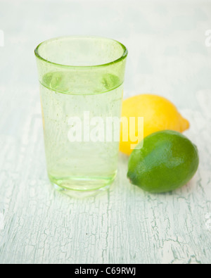 A glass of sparkling water with lemon and lime - Stock Photo