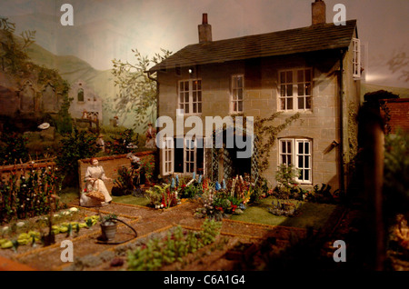 Helen Holland who makes dolls houses which are on exhibition at Leonardslee Gardens near Horsham - Stock Photo