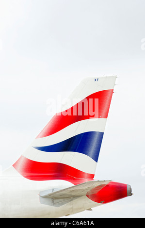 Tail and logo on a British Airways aircraft - Stock Photo