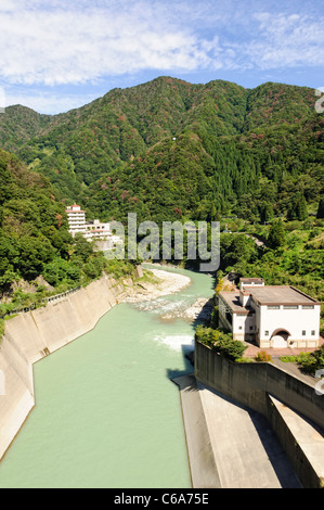 River / reservoir downstream from dam used for electric power generation, rural Japan