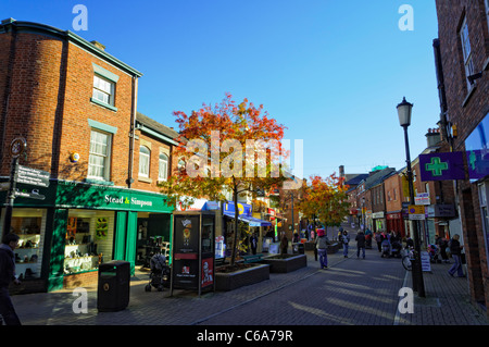 Pedestrianised main street of a typical small English town, with typical shops. Everyday life in small town UK. - Stock Photo