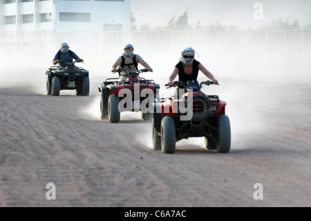 Off roading in the deserts of South Sinai, tourists & Egyptians ride all terrain vehicles (ATV's) for leisure sports - Stock Photo