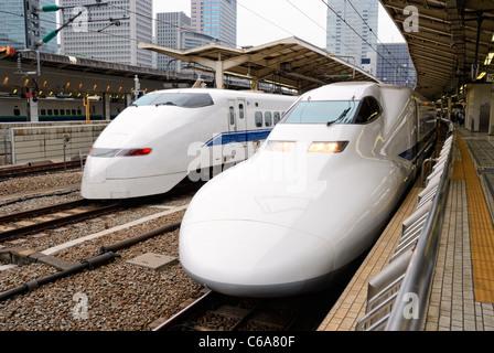 Japanese high speed shinkansen trains (bullet trains) at Tokyo station - Stock Photo