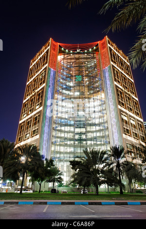High-rise buildings on Corniche Road, illuminated with LED lights, Abu Dhabi - Stock Photo