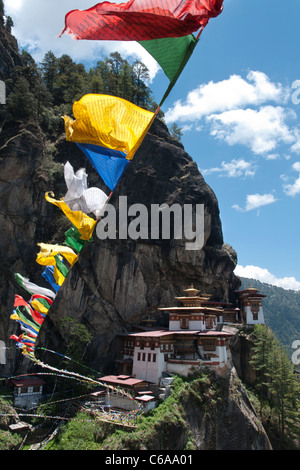 Taktshang Goemba. Tigers nest monastery. view with prayer flags and cliff. Paro valley, bhutan - Stock Photo