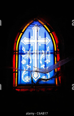 Stained glass window on a grave or mausoleum in the graveyard at the Pere Lachaise cemetery in Paris, France - Stock Photo