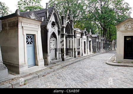 Mausoleums and graves in the graveyard at the Pere Lachaise cemetery in Paris, France - Stock Photo
