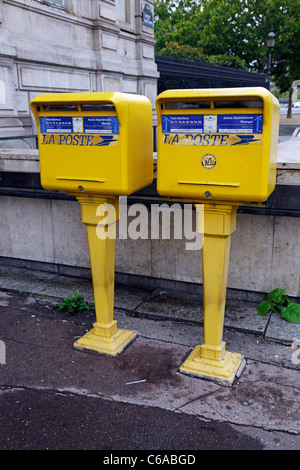 Yellow French Poste post boxes in Paris, France - Stock Photo