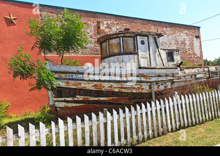 Old Greek fishing trawler boat on display on a street in Apalachicola, Florida - Stock Photo