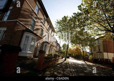 red brick victorian terraced housing on a typical English street - Stock Photo