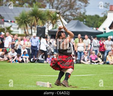 Competitor competing in a Hammer Throwing Competition (Scottish Standing Style) at Brodick Highland Games, Isle - Stock Photo