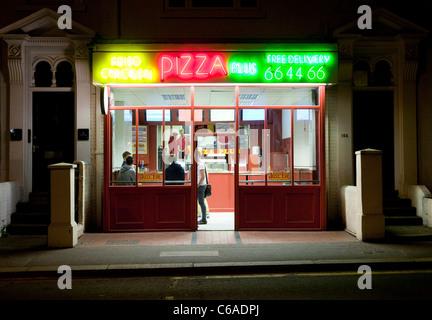Pizza Plus takeaway restaurant in Norwich, UK - Stock Photo