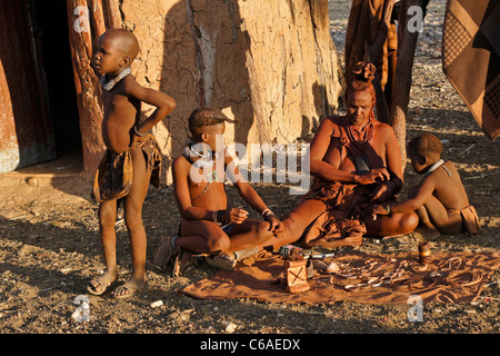 Himba mother and children in village near Opuwo, Namibia - Stock Photo